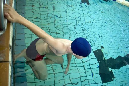 Start a teenager in the pool  of backstroke Stock Photo