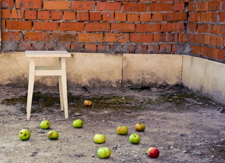 apples scattered on the floor against the backdrop of the old interior photo