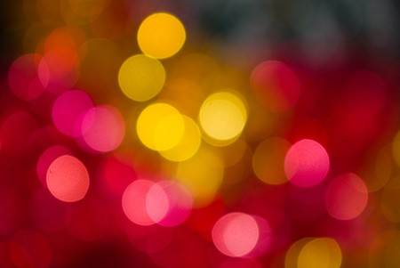 The colored abstract christmas lights as background Фото со стока
