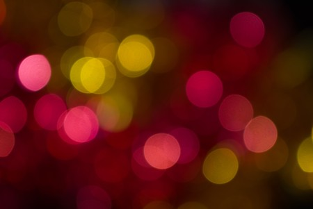 The colored abstract christmas lights as background photo