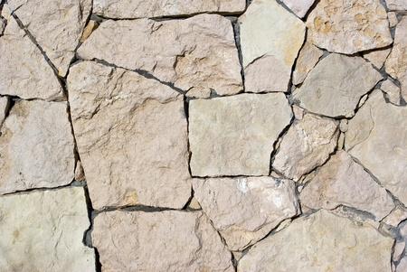 様々 なサイズの幾何学的な石と石の擁壁 写真素材