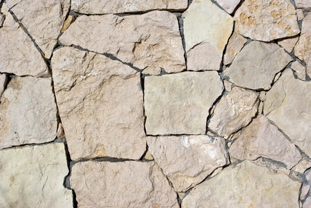 stone retaining wall with various size geometric stones photo