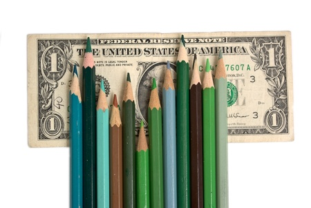 colored pencils as a graphic on a background of money photo