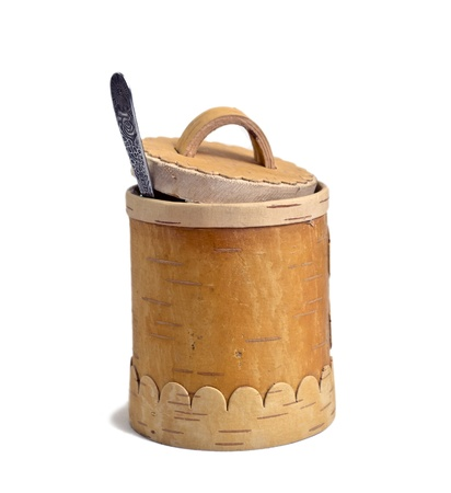 barrel of the honey with spoon on white background, isolated photo