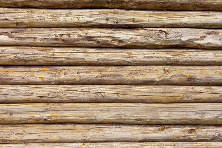 農村住居の背景の木の丸太の壁 写真素材