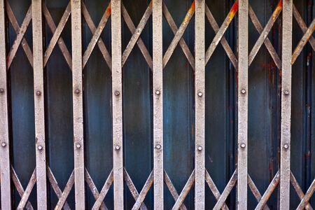 Rusty old corrugated iron fence close up. photo