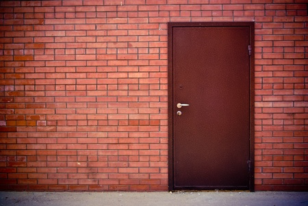 the Red brick wall and the iron closed door Stock Photo - 12449100