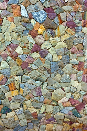 the colored Pattern of old stone Wall Surfaced Standard-Bild