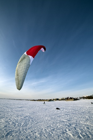 the Ski kiting on a frozen lake Stock Photo - 12746256