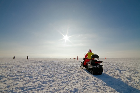 the snowmobile on a beautiful winter landscape photo