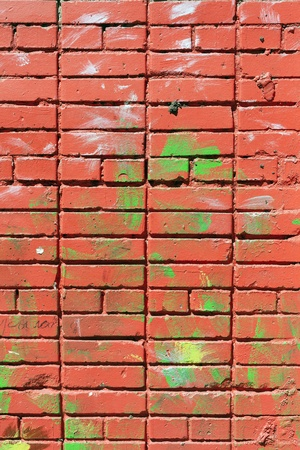 Grunge cracked pink painted brick wall high detailed photo
