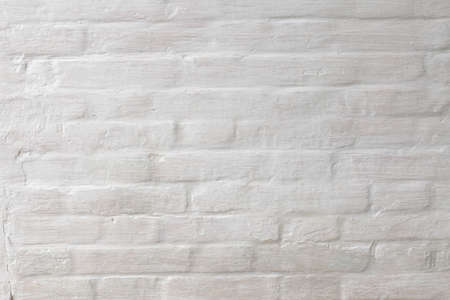 Abstract weathered texture stained old stucco light gray and aged paint white brick wall background in rural room Standard-Bild