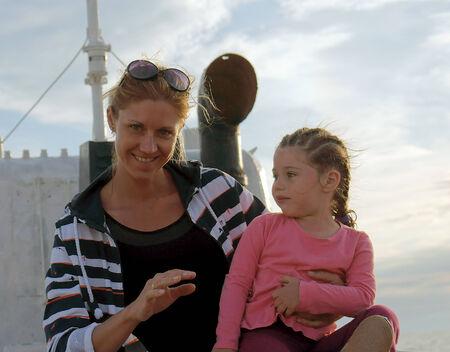 azov sea:       Russia, Azov sea, 18.06.2014, mother, daughter 3 years smiling at sea-the white boat                   Editorial