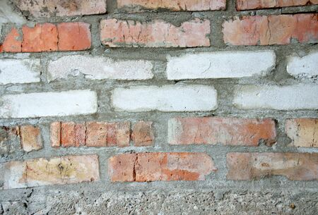 The masonry is of white and red bricks Stock Photo