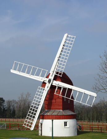 A windmill in a landscape with a blue sky