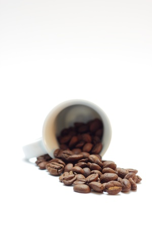 Espresso beans with a cup