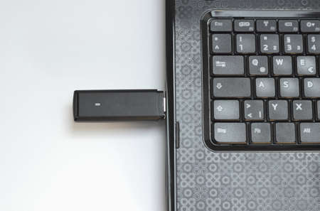 USB Internetstick is connected with a Notebook Stock Photo