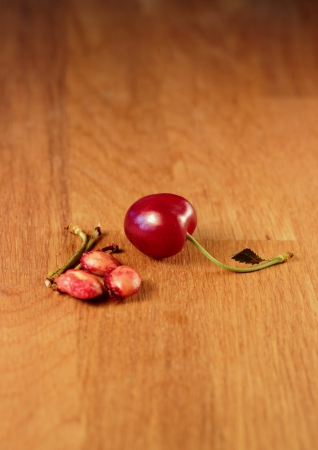 pits: A cherry with pits and stems Stock Photo