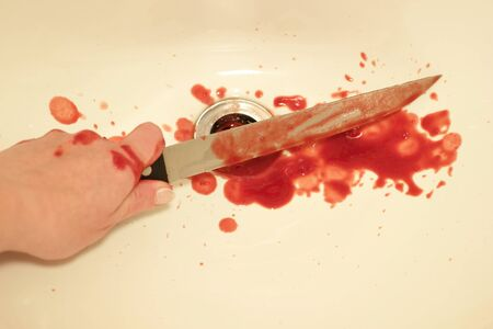 smeared hand: Bloody knife Stock Photo