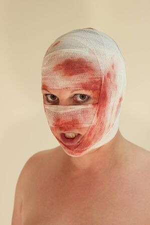 A woman with a bloody bondage on her face