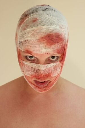 A woman with a bloody bondage on her face Stock Photo - 14614997
