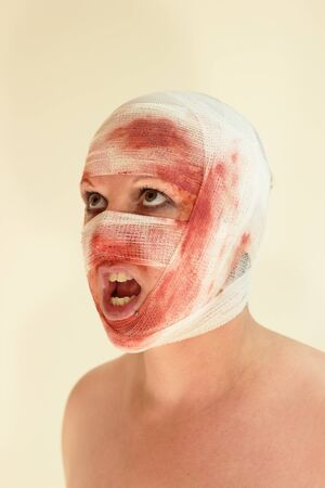A woman with a bloody bondage on her face Stock Photo - 14614993