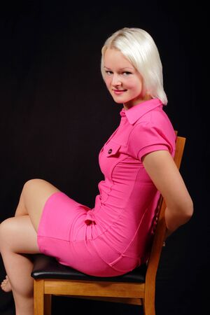 Woman in a pink dress sitting on a chair Stock Photo - 15718935