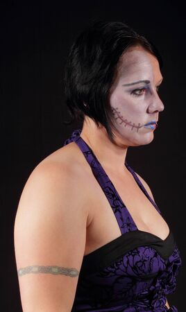 A woman with makeup for halloween - Two Face