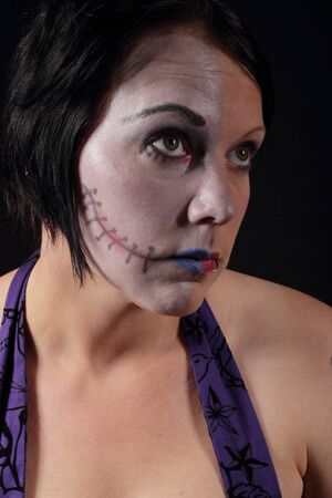 A woman with makeup for halloween - Two Face Stock Photo - 16549600