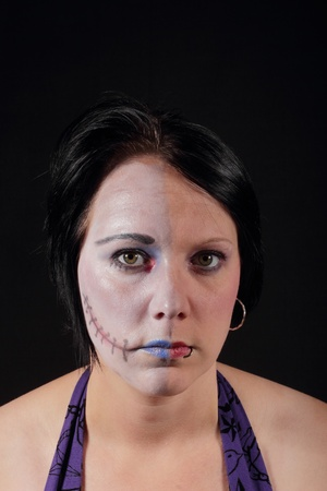 A woman with makeup for halloween - Two Face Stock Photo - 16549596