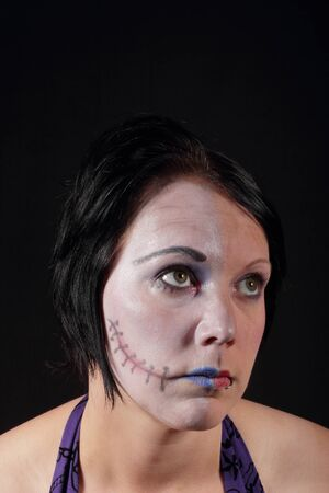 A woman with makeup for halloween - Two Face photo