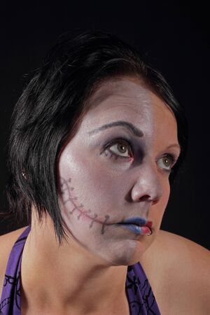 A woman with makeup for halloween - Two Face Stock Photo - 16549602