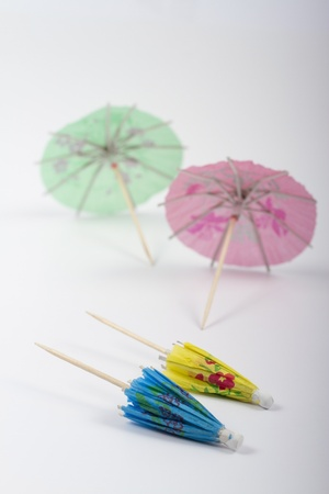 spanned: Small umbrellas isolated on a white background Stock Photo
