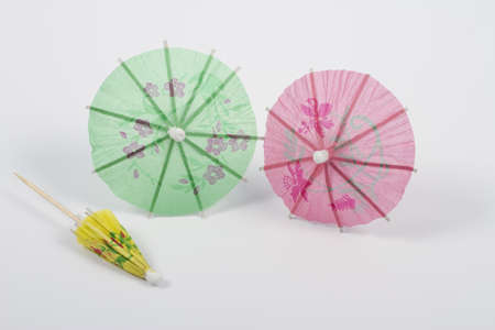 Small umbrellas isolated on a white background photo