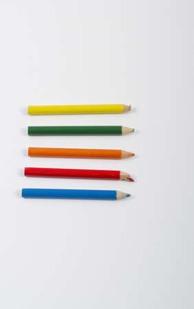 Used crayons isolated on a white background Stock Photo