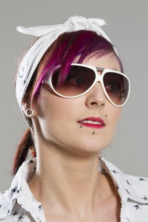 Young woman in Rockabilly style with sunglasses