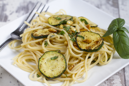 Spaghetti with zucchini and pine nuts