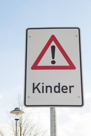 Attention children sign in German language Stock Photo