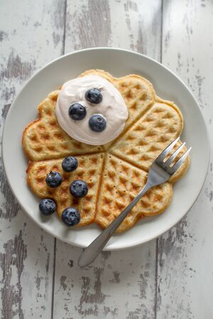 Waffle with cream and blueberries