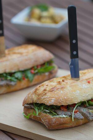 downloaded: Steak sandwich on a wooden board