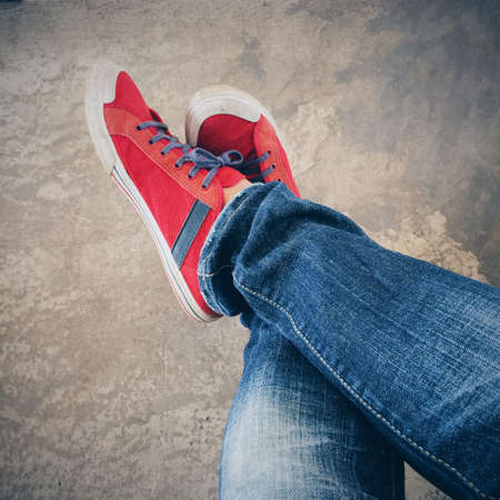 jeans: Blue jeans and red shoes in vintage style.