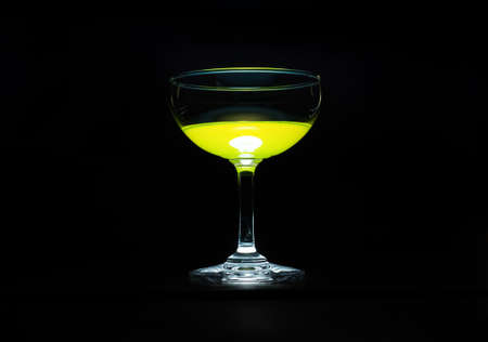 yellow to drink: Yellow drink a glass of champagne on black background.