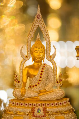 places of worship: Golden buddha statue in temple. Places of worship.