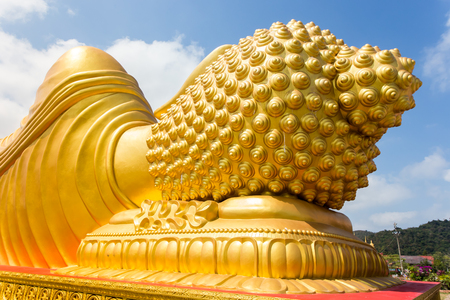 temple: Backside of golden buddha statue in temple.