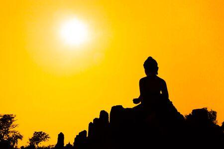buddha tranquil: Silhouette big buddha statue in sunset background.