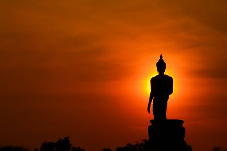 spiritual architecture: Silhouette big buddha statue in sunset background.