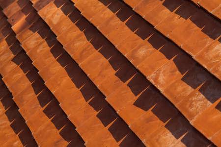arranged: Orange tiles placed arranged as background. Stock Photo