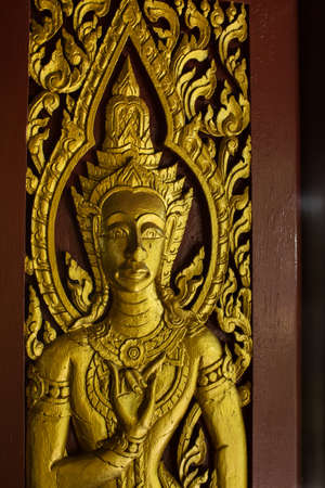 wood carvings: Wood carvings on the temple walls in public. Buddha wooden carving.