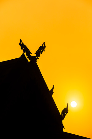 sun roof: Silhouettes of roof pavilion with sunset. Focus on the sun. Stock Photo