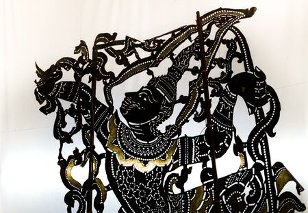 shadow puppets: Traditional Thailand shadow puppet show. Puppets made of leather.